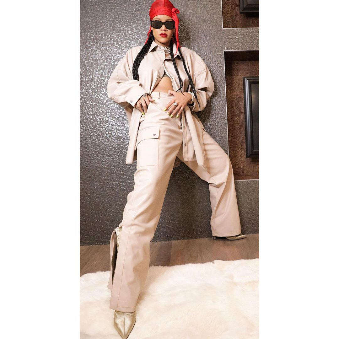 Rihanna Fenty faux leather shirt pants and Parachute boots, black sunglasses and red durag