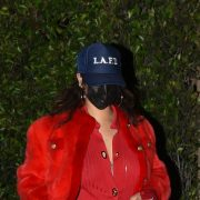 Rihanna red fur jacket, Bottega Veneta ribbed cardigan, LAFD blue trucker hat, Fenty x Amina Muaddi white corset lace up pumps