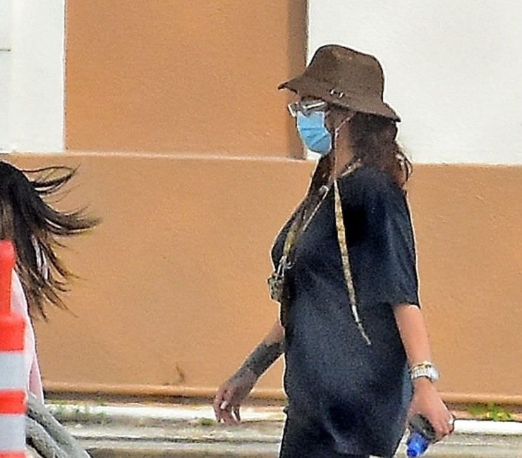 Rihanna Gucci bucket hat, Fenty Side Note sunglasses and Meshy mules